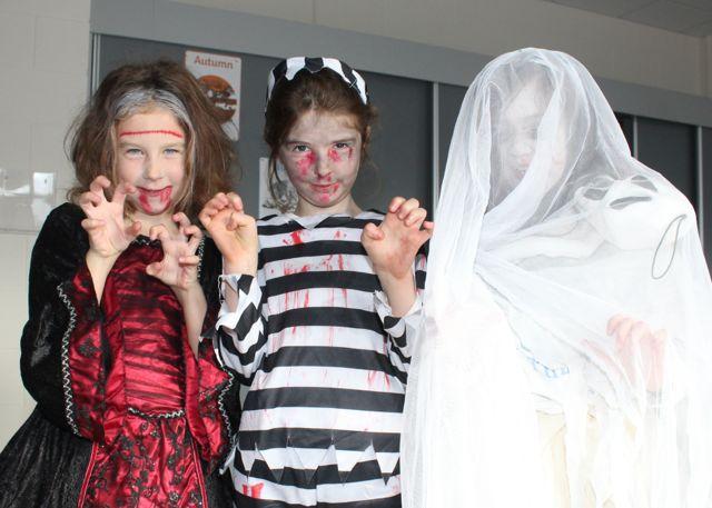 Caoileann Culloo, Leah Kelliher and Emily O'Regan enjoying Halloween fun at St Brendan's NS Blennerville on Friday. Photo by Dermot Crean