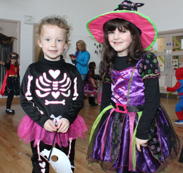 Grace Falvey and Saoirse O'Connor enjoying Halloween fun at St Brendan's NS Blennerville on Friday. Photo by Dermot Crean