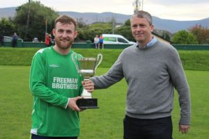 Barry John Keane accepts the Under 35s trophy on behalf of 'The Boys From The Avenue' from one of the organisers, Cllr Pa Daly. Photo by Dermot Crean