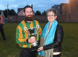 Padraig Moynihan accepts the Over 35s trophy on behalf of Kerry County Council team from Breda Dyland of Kerry Cancer Support Group. Photo by Dermot Crean