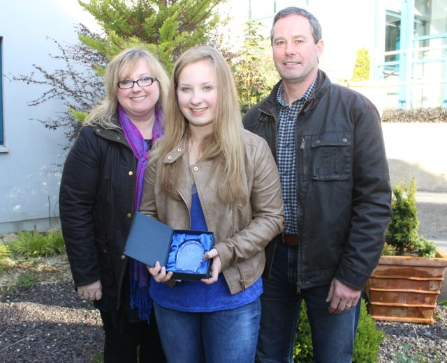 Laura Harty, who got 11As in her Junior Cert, with parents Mary and Paddy, at the Mercy Mounthawk awards for high-achieving students in State exams on Saturday. Photo by Dermot Crean