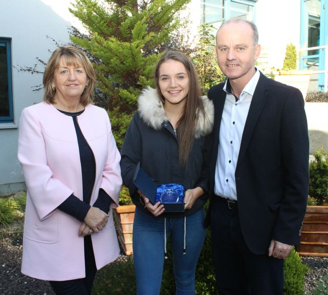 Niamh McMahon, who got 8As in her Junior Cert, with parents Mary and Joe, at the Mercy Mounthawk awards for high-achieving students in State exams on Saturday. Photo by Dermot Crean
