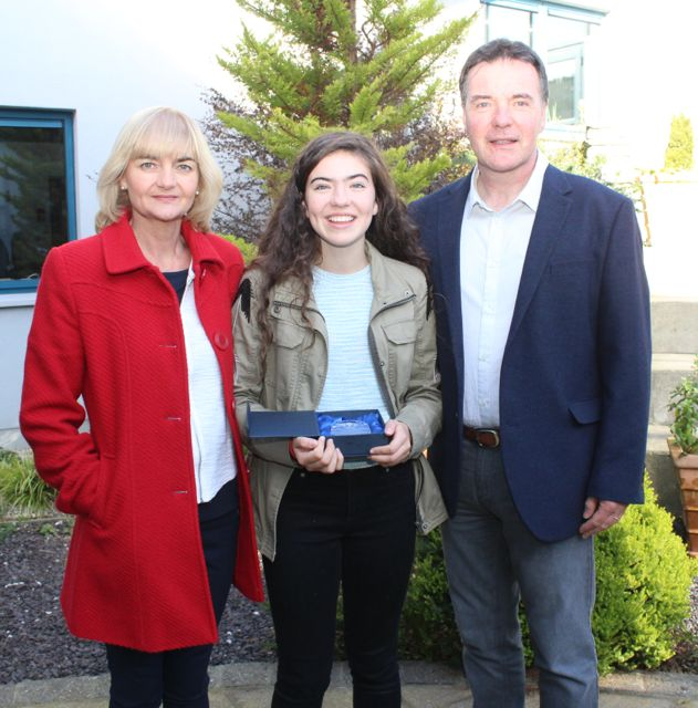 Katie Crowe who got 8As in her Junior Cert, with parents Gillian and Declan, at the Mercy Mounthawk awards for high-achieving students in State exams on Saturday. Photo by Dermot Crean