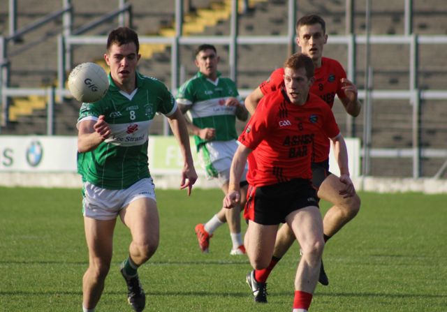 Jack Barry on the attack followed by Pa Kilkenny. Photo by Dermot Crean