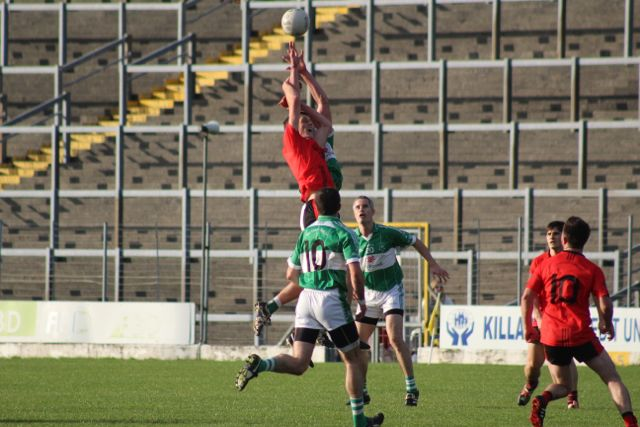 Colm McGillycuddy and Jack Barry rise highest for the ball. Photo by Dermot Crean