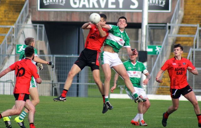 Colm McGillycuddy and Jack Barry contest a kickout. Photo by Dermot Crean