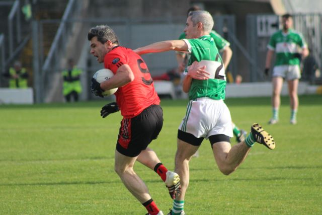 Fergal Griffin is challenged by Eoghan Sheehy. Photo by Dermot Crean