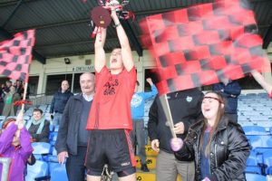 Colm McGillycuddy lifts the Tom Keane Memorial Cup. Photo by Dermot Crean