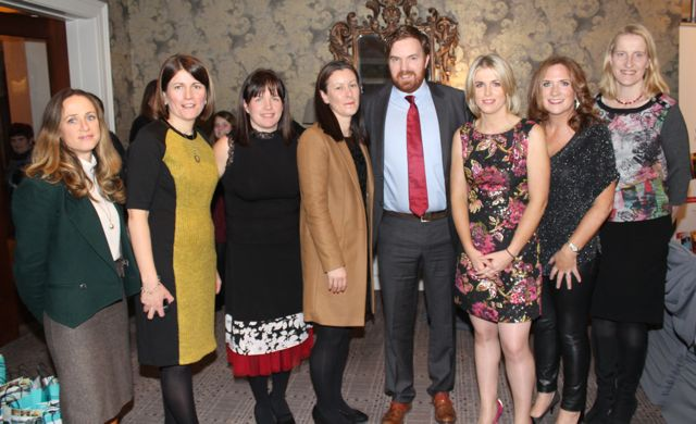 Co-MC for the evening, RTE star Bernard O'Shea, with Ailbhe Keogan, Aine O'Dwyer, Liz Moore, Caroline Hayes, Jennifer Barry, Catherine Keane and Susan Keane at the Aughacasla NS Fashion Show at the Rose Hotel on Friday night. Photo by Dermot Crean