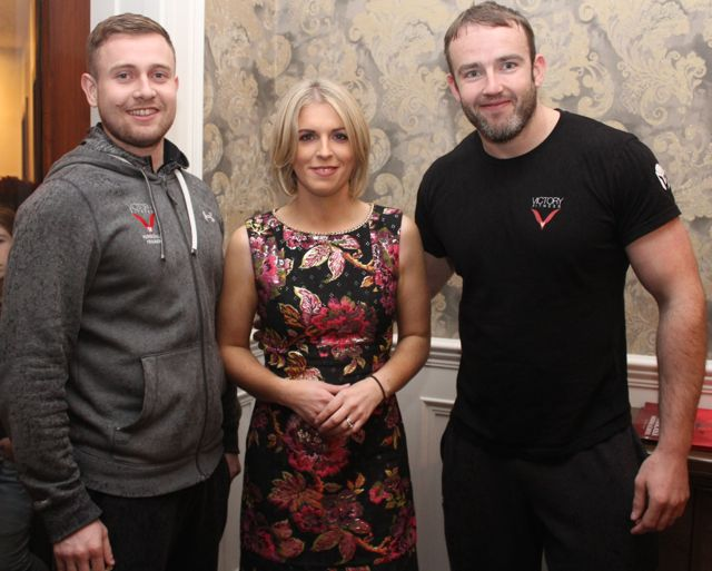 Jennifer Barry with Peter Donoghue and Ronan Kiely from Victory Fitness at the Aughacasla NS Fashion Show at the Rose Hotel on Friday night. Photo by Dermot Crean