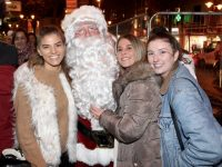Christina O'Carroll, Emma O'Gorman and Sinead Hilliard meet Santa while queuing for the CH Chemists Customer Night on Friday. Photo by Dermot Crean