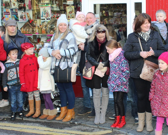 Crowds gather at the CH Chemists Christmas Parade on Saturday. Photo by Dermot Crean