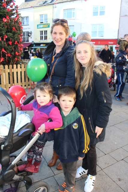 Brid, Aoibhin, Eoin Lyne and Caoimhe Fitzgerald at the CH Chemists Christmas Parade on Saturday. Photo by Dermot Crean