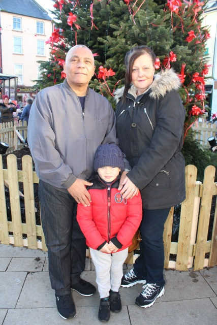 Alan, Scott and Elizabeth Akinyemi at the CH Chemists Christmas Parade on Saturday. Photo by Dermot Crean