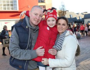 Stephen, Sarah and Therese Greaney at the CH Chemists Christmas Parade on Saturday. Photo by Dermot Crean