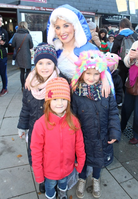 Ellie, Erin and Abbie Mitchell at the CH Chemists Christmas Parade on Saturday. Photo by Dermot Crean