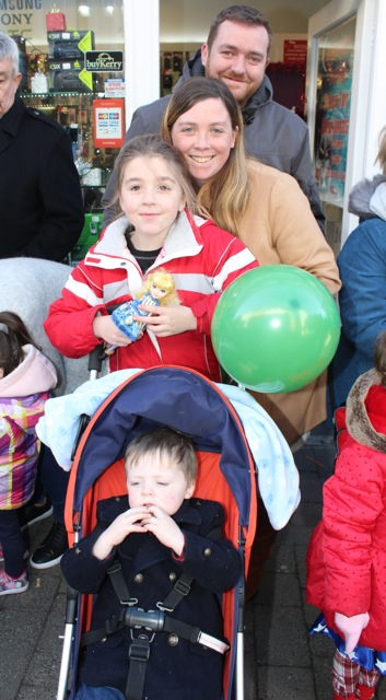 Sarah and Keith Mason with Alex and Chloe Mason at the CH Chemists Christmas Parade on Saturday. Photo by Dermot Crean