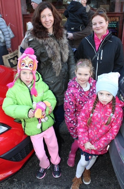 Caroline Reidy and Lucy Laide with Keelin Reidy, Katelyn Laide and Kaela Reidy at the CH Chemists Christmas Parade on Saturday. Photo by Dermot Crean
