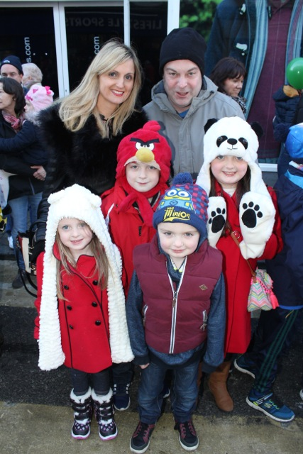Angelina and Johnny Moriarty with Kayla, Darragh, Jayden and Alana Moriarty at the CH Chemists Christmas Parade on Saturday. Photo by Dermot Crean