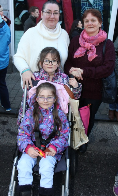 Caroline Cronin O'Sullivan and Noreen O'Sullivan with Erin and Megan O'Sullivan at the CH Chemists Christmas Parade on Saturday. Photo by Dermot Crean