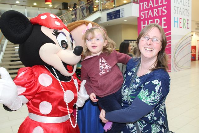 Róisín O'Connor with mom Mary meeting Minnie at the Manor West Family Fun Day on Saturday. Photo by Dermot Crean