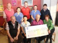 Frank O'Donnell (seated left) and Mary Fitzgerald (seated right) present the €1,000 winning prize from John Mitchels 'Strictly Come Dancing' to Teresa Walsh of the Oncology Unit at UHK. Also seated in John O'Halloran, John Mitchels Club Treasurer. At back; John Mitchels Club Chairman Denis Mannix, Sandra Murphy, David Leahy of John Mitchels, Michelle Doolan and John Mitchels PRO Theresa Deane. Photo by Dermot Crean