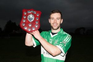 Na Gaeil Captain Mike Griffin with the plaque after his side defeated Fossa in the in the County League Division Four Final.