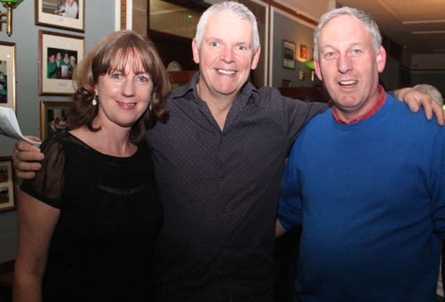 Niamh Murphy, Troy O'Connell and Charlie O'Sullivan at the Na Gaeil Race Night on Saturday night. Photo by Dermot Crean