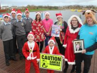 Launching the Santa 5k Run at Tralee Bay Wetlands on Wednesday were, in front, Sophie and Jamie Quillinan and Deirdre and Martin Moore. At back; CBS students Micheál Dolan, Cormac Lynch, Caoimhin Finn, Eoin Healy and Niall Fitzmaurice, Mags Quillinan, Helen Kelliher and Aoife Moynihan. Photo by Dermot Crean