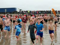 PHOTOS: Banna Swim Draws Hundreds On Christmas Day