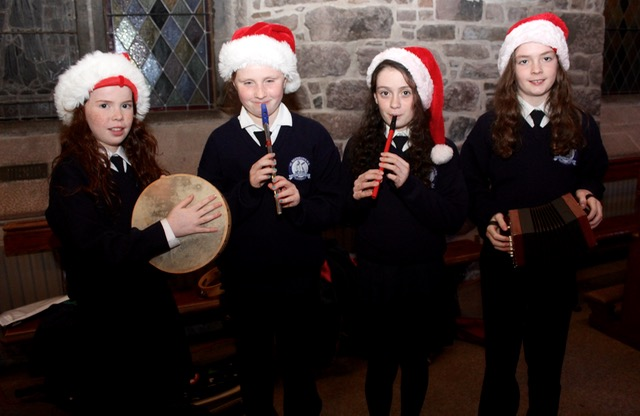 Roisin Griffin, Caoilinn O'Brien, Siobhan O'Sullivan and Caoimhe O'Sullivan at the St Brendan's NS Blennerville Christmas Concert on Tuesday night. Photo by Dermot Crean