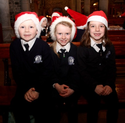 Jack Maguire, Ciara Higgins and Kerry Falvey at the St Brendan's NS Blennerville Christmas Concert on Tuesday night. Photo by Dermot Crean