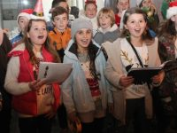 Caherleaheen NS pupils singing for charity in The Mall. Photo by Dermot Crean