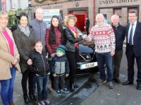 Marion Galvin (centre) receives the  new Nissan Pulsar from Manager of Tralee Credit Union, Fintan Ryan. Also included is, from left; Marcella Herlihy of Tralee Credit Union, Catriona, Rachel, Trevor and Luke Galvin, Denis Galvin and David Randles of Randles Brothers Nissan dealers. Photo by Dermot Crean