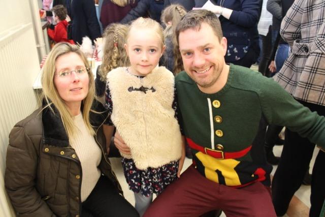 Marie, Ava and Philip Dewey at the Gaelscoil Mhic Easmainn Christmas Fair on Sunday. Photo by Dermot Crean