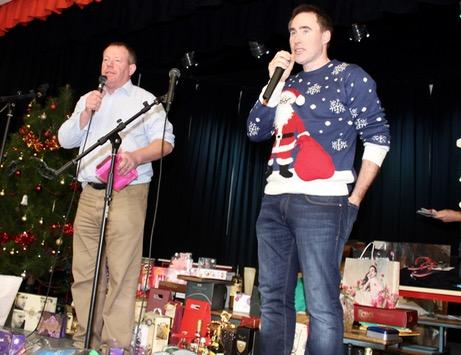 Tomás Ó hAiniféin and Tim Lynch on auctioneering duties at the Gaelscoil Mhic Easmainn Christmas Fair on Sunday. Photo by Dermot Crean
