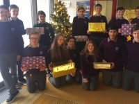 Second Year students from Coláiste Gleann Lí with the shoeboxes for Arlington Lodge.