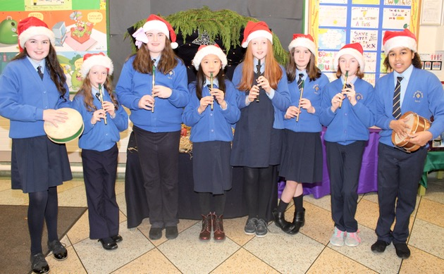 Elysha Daughton, Lana O'Connell, Clodagh McCluskey, Jing Wen Lin, Niamh Hennessy, Latoya Scannell Byrne, Grainne Clifford and Alanna Looby who performed in the Presentation Primary Christmas Concert on Wednesday morning. Photo by Dermot Crean