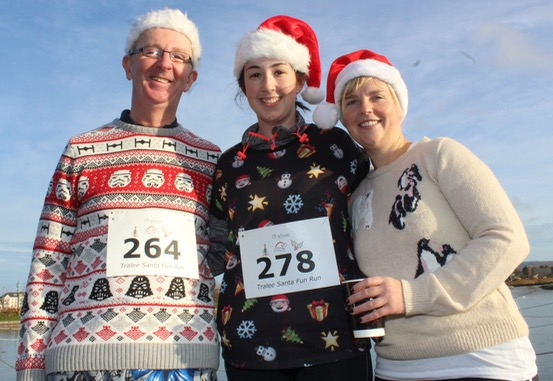 Kieran and Mary O'Shea and Angela Curran at the Santa 5k Fun Run on Sunday morning. Photo by Dermot Crean