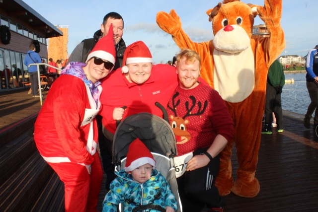 Rachel McCann, Patrick Roberts, Kathy Roberts and Padraig O'Mahony with Kieran Roberts in the buggy at the Santa 5k Fun Run on Sunday morning. Photo by Dermot Crean