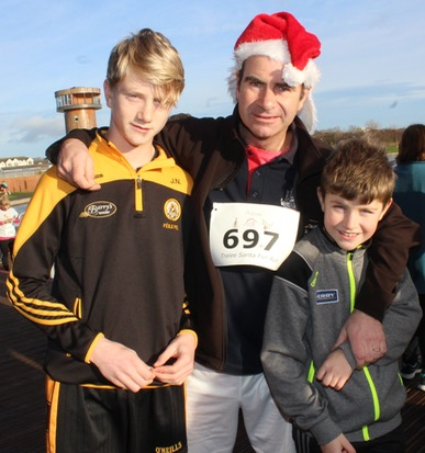 Joey, Malachy and Barry Nagle at the Santa 5k Fun Run on Sunday morning. Photo by Dermot Crean