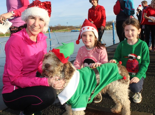 Avril, Hazel and Abigail Geary with 'Ivy' at the Santa 5k Fun Run on Sunday morning. Photo by Dermot Crean