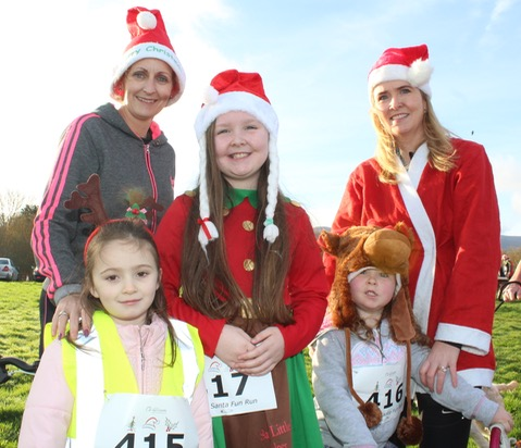 Charlotte Devane, Ailbhe Hennessy, Laoise, Caoileann and Karen O'Carroll at the Santa 5k Fun Run on Sunday morning. Photo by Dermot Crean