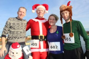 Stephen Byrne, Paul Knightly, Maria Moynihan and Danny Riordan at the Santa 5k Fun Run on Sunday morning. Photo by Dermot Crean