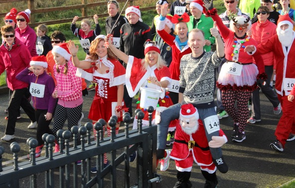 Participants take off at the Santa 5k Fun Run on Sunday morning. Photo by Dermot Crean
