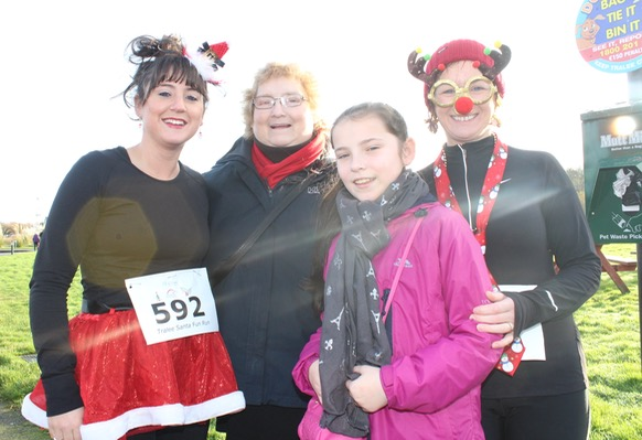 Katie, Annie, and Maria O'Sullivan and Kathleen O'Donoghue at the Santa 5k Fun Run on Sunday morning. Photo by Dermot Crean