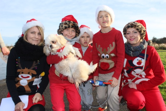 Magda, Bruno and Max Grzybowsky with Marcel and Marta Kovwse at the Santa 5k Fun Run on Sunday morning. Photo by Dermot Crean
