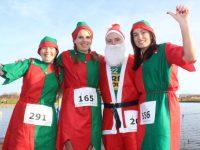 Audrey Rigney, Julie Deenihan, Damien Kissane and Sandra O'Riordan at the Santa 5k Fun Run on Sunday morning. Photo by Dermot Crean