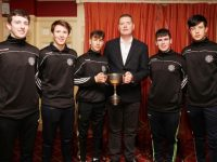 Pictured are Ballymac u 16 players Josh O Keeffe,James Mc Donnell,Daire Keane,Barry Lyons and Tadhg Brick with Co Board chairman Tim Murphy at the recent medal presentation for the winning Castleisland District U 16 Co Championship team