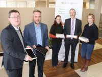 Sean Scally (left) of Enable Ireland Kerry accepts iPads purchased by Aspen Grove for the facility. Included is Sean Ryan, CEO Aspen Grove, Anne Marie O'Flaherty, Tommy Brennan and Charlene Doody, Aspen Grove. Photo by Dermot Crean